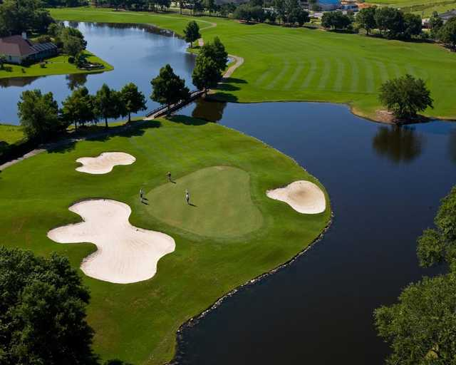A view of a green protected by three bunkers at Craft Farms Resort