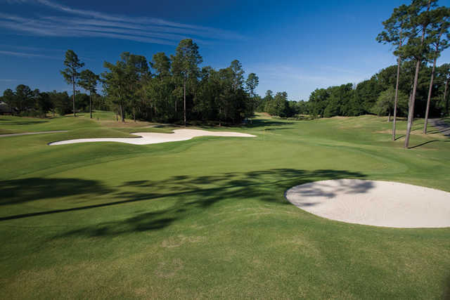 A view of the 9th green flanked by bunkers at Magnolia from TimberCreek Golf Club