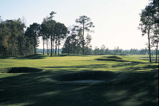 A view of a hole protected by sand traps at Wicked Stick Links