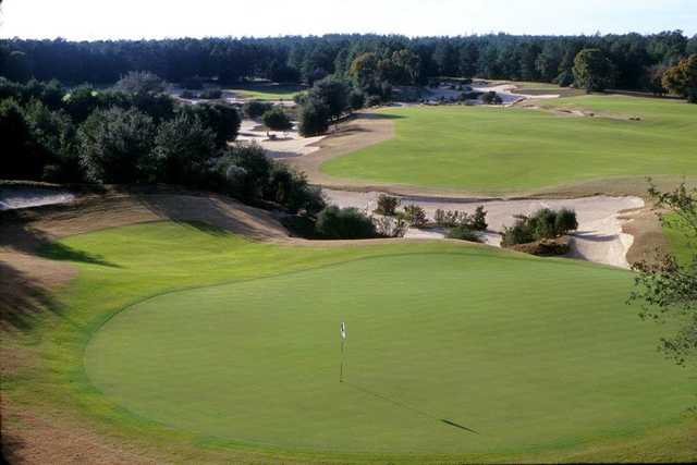 A view of a green protected by sand traps at World Woods Golf Club