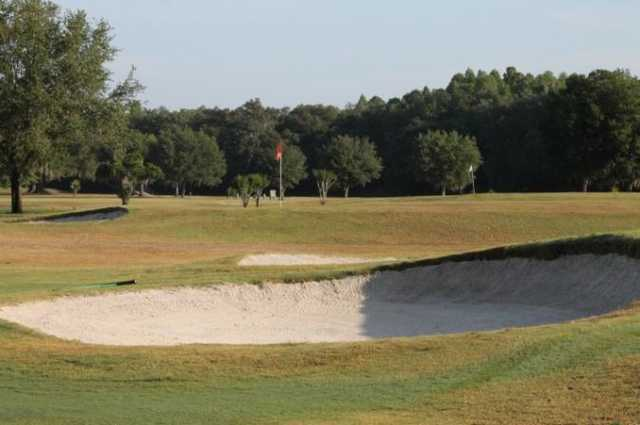 A view of hole #14 guarded by bunkers at Bartow Golf Course