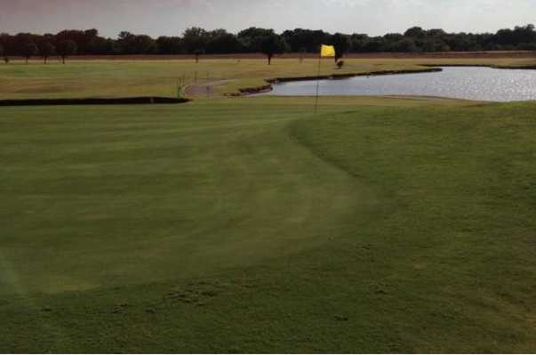 A view of a hole with water coming into play at Kingfisher Golf Course