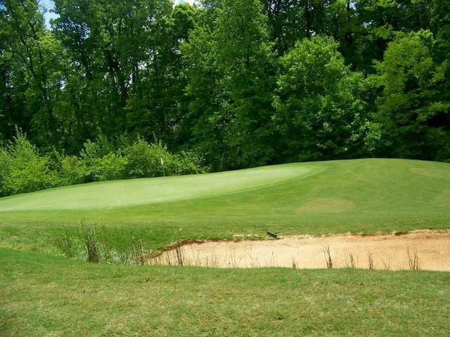 A view of a hole protected by a bunker at Williams Creek Golf Course