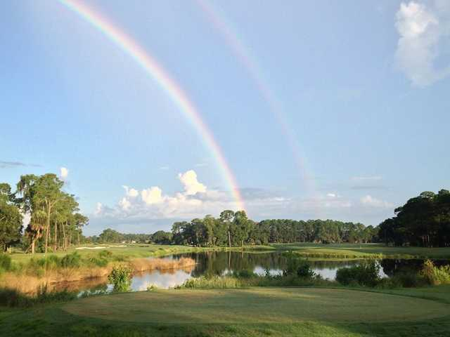 A double rainbow view over Grand Club Pine Lakes Course