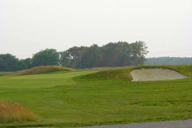 A view of a green protected by a bunker at McCullough's Emerald Golf Links