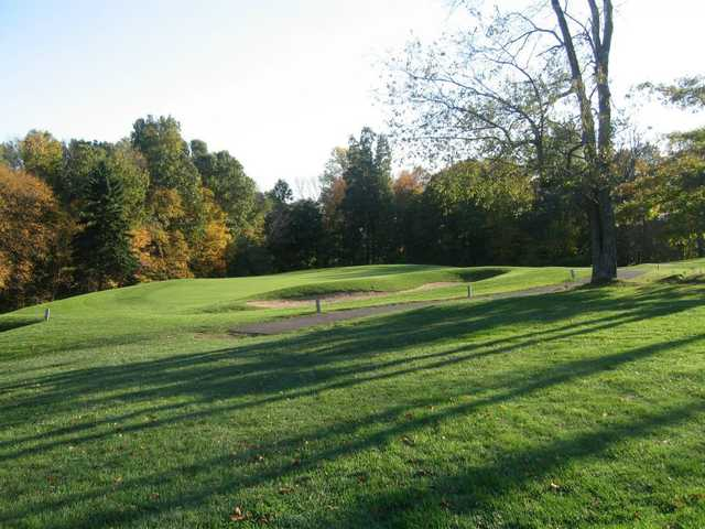 A view of a hole protected by a bunker at Indian Springs Golf Club