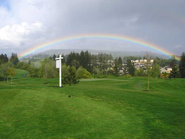 A view of a ainbow over hole #1 at Chehalem Glenn Golf Club