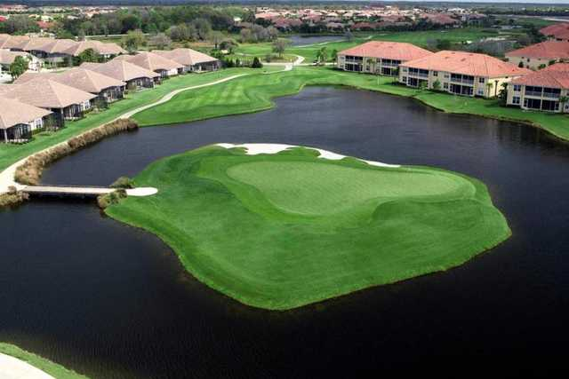 Aerial view of hole #17 surrounded by water at Legacy Golf Club