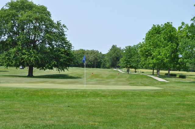 A view of a hole with a narrow path on the right side at Hawk's Tail of Greenfield
