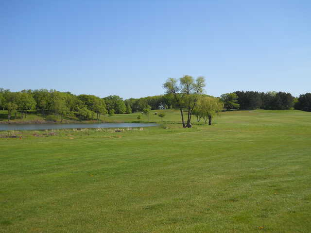 A view from the 14th fairway with a pond on the left side at Kimball Golf Club