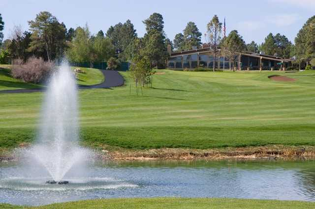 A view of a fairway with a water fountain in foreground at Continental Country Club