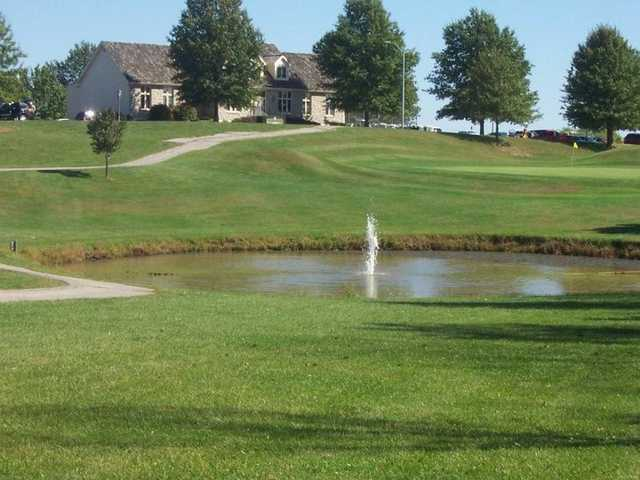 A view of hole #9 with a water fountain in foreground at Teetering Rocks Links