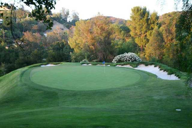 A view of a hole protected by sand traps at Woodland Hills Country Club