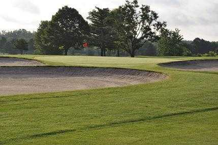 A view of a green protected by tricky sand traps at Kittyhawk Golf Center
