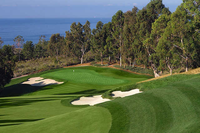 A view of a hole surrounded by tricky bunkers at Ocean South from Pelican Hill Golf Club