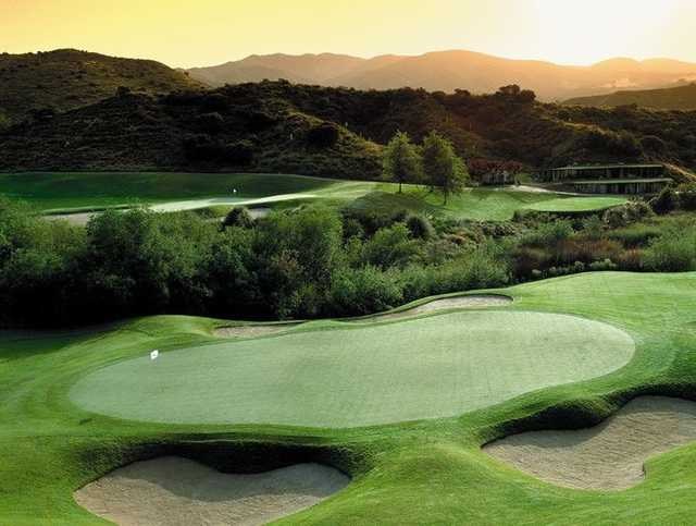 A view of a green protected by bunkers at Dove Canyon Country Club