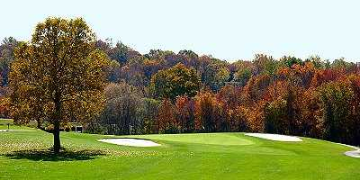 A view of a green flanked by bunkers at Twin Lakes