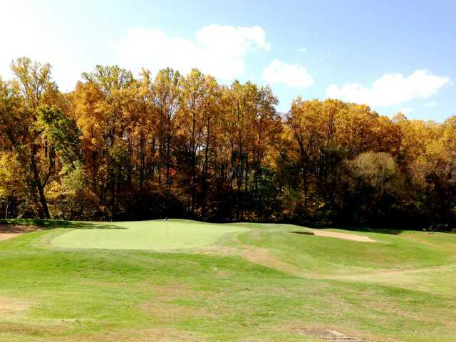 A view of a green flanked by bunkers at Montclair Golf, Tennis, & Swim Club
