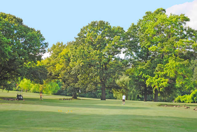 A sunny day view of a hole at Langston Golf Course