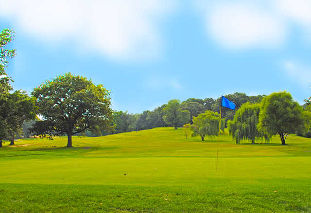 A view of a hole and a fairway at Langston Golf Course
