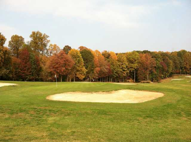 A fall view of a green at Severna Park Golf Center
