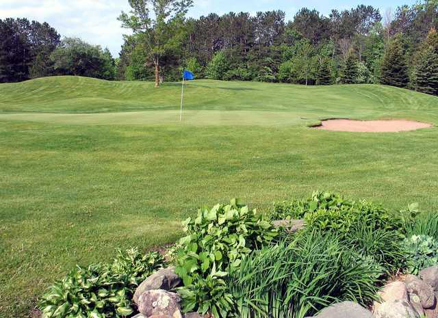 A view of a hole with a bunker on the right side at Luck Golf Course