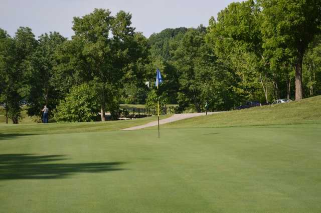 A view of a hole with a narrow path in background at Lucas Oil Golf Course
