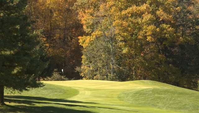 A sunny day view of a green at Boone Golf Club