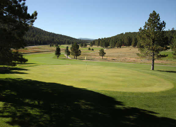 A sunny day view of a hole at Angel Fire Resort Country Club