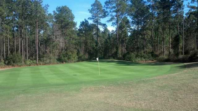 A sunny day view of a green at Lakes Golf Course from Laura Walker State Park