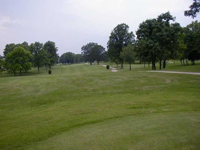 A view of a fairway with a narrow path at Rolling Hills Golf Course