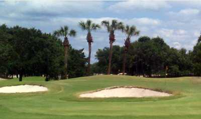A view of a green protected by sand traps at Countryway Golf Club