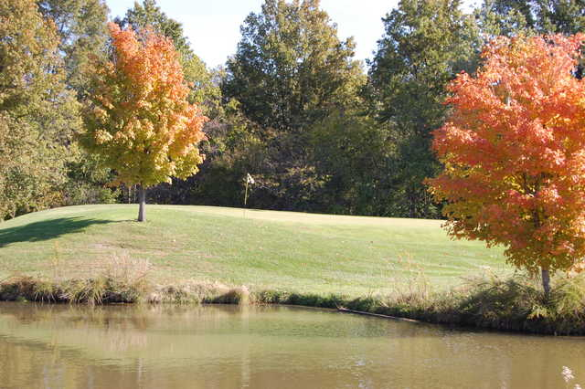 A view over the water of a hole at Par 3 from Governors Run Golf & Country Club