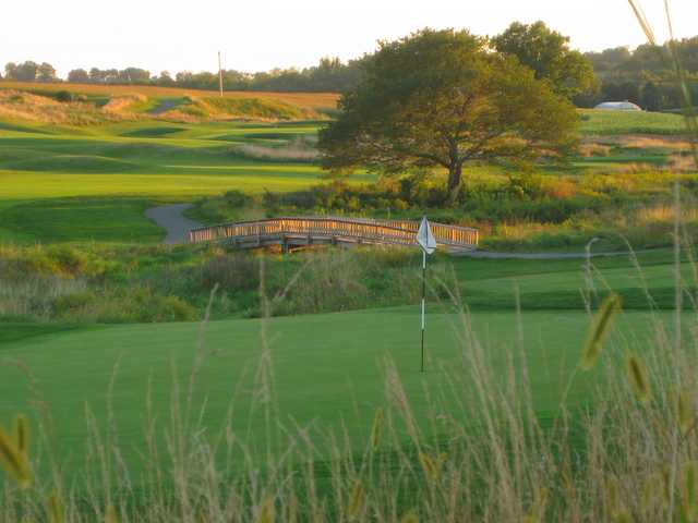 A view of a hole with a bridge in background at Wyncote Golf Club