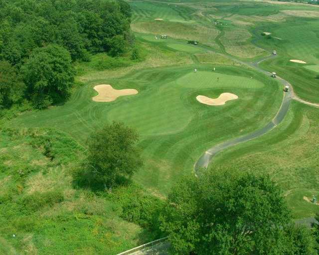 A view of a hole flanked by sand traps at Wyncote Golf Club