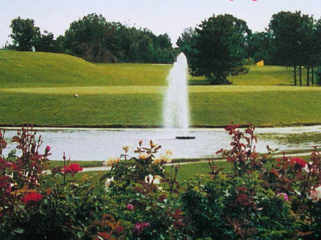 A view over the water of a green at Island Lake Golf & Training Center