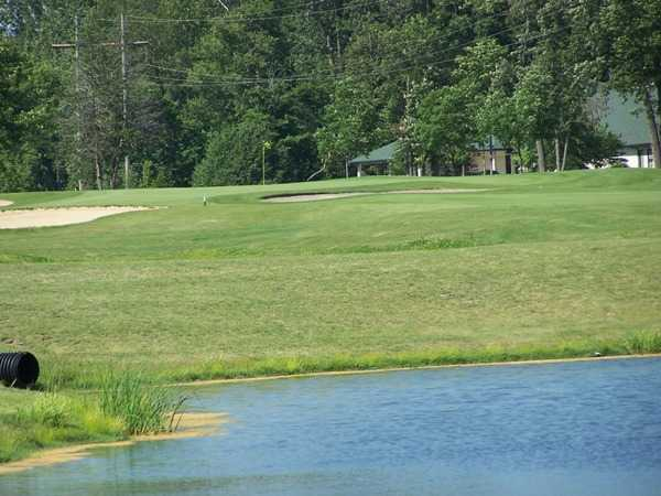 A view over the water of the 9th green at East Course from Bridgewater Golf Club