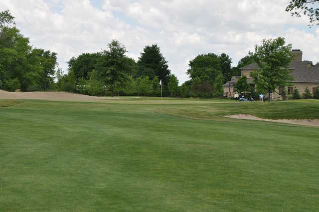 A view of a hole flanked by sand traps at Hawk's Tail of Greenfield