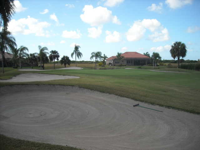 A view of a hole surrounded by sand traps at Cape Royal Golf Club