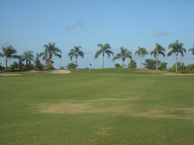 A view of a green flanked by sand traps at Cape Royal Golf Club