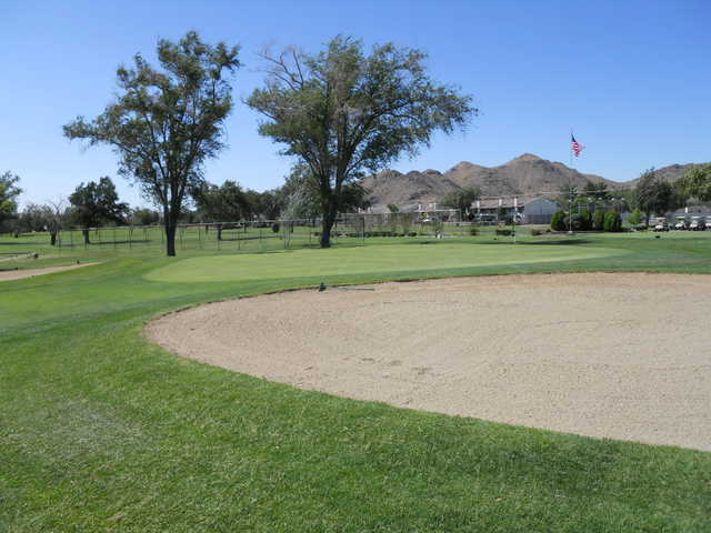 A view of green #18 protected by sand traps at Apple Valley Golf Course