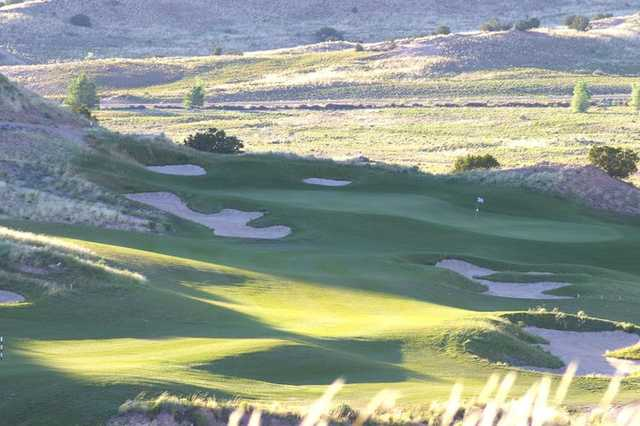A view of green #7 surrounded by sand traps at Black Mesa Golf Club
