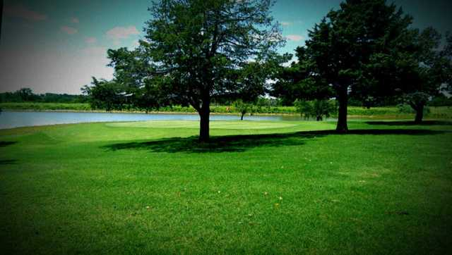 A view of a green with water coming into play at Guthrie Golf & Country Club
