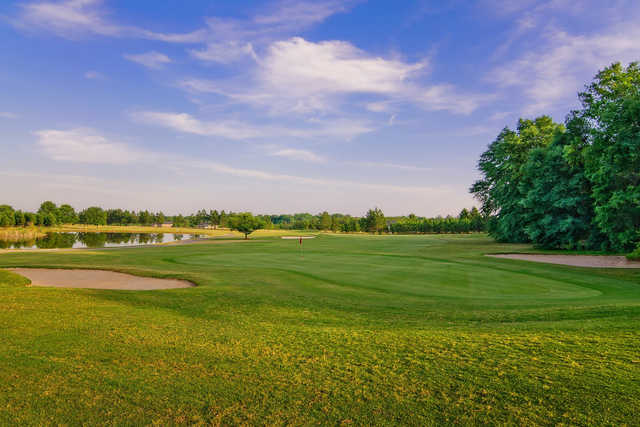 A view of a green with water and bunkers coming into play at Applewood Golf Course