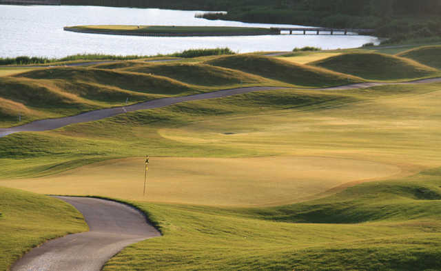 A sunny view of a hole at Lost Marsh Golf Course