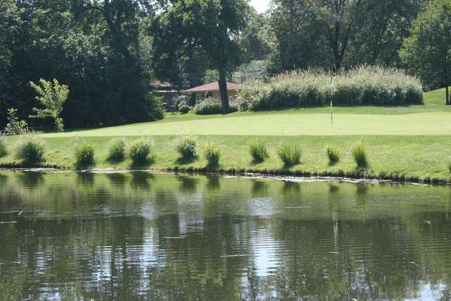 A sunny day view of a hole at Flag Creek Golf Course