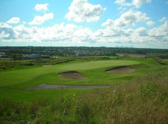 A view of a green protected by bunkers at Willow Hill Golf Course