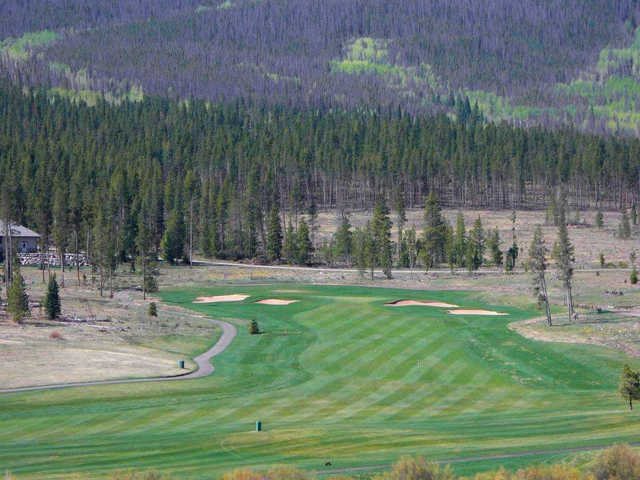 A view of a green flanked by bunkers at Pole Creek Golf Club