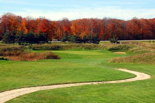 A fall view of a tee at Northern Dunes Golf Club