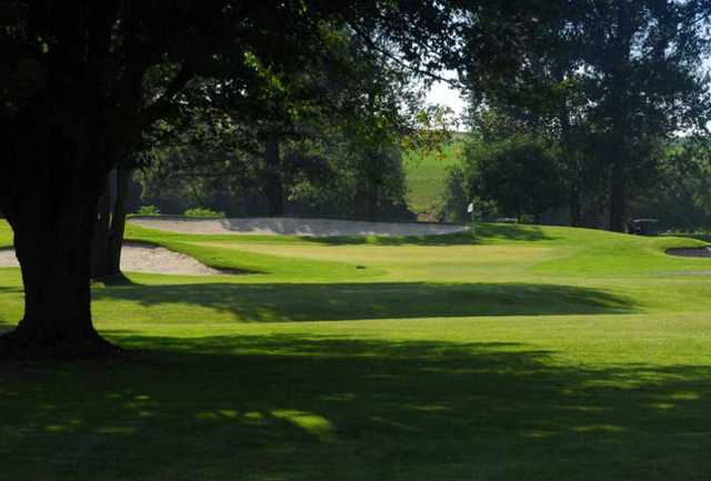 A view of a hole flanked by tricky sand traps at Conestoga Golf and Country Club